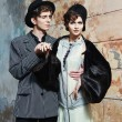 Retro styled fashion portrait of a young couple. Clothing and ma — Foto Stock