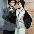 Retro styled fashion portrait of a young couple. Clothing and ma — Stock Photo