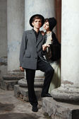 Retro styled fashion portrait of a young couple. — Stock Photo