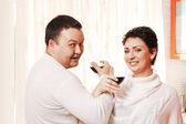 Family in home kitchen drinking wine. Brotherhood — Stock Photo