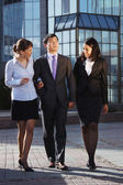 Business walking and talking in the street. — Stock Photo