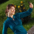 Woman posing for a photograph taken from his cell phone — Stock Photo