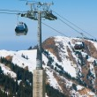 Cable car going to ski resort — Stock Photo