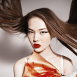 Stock Photo: Photo of beautiful asiwomwith magnificent hair. Fashion ph