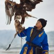 Stock Photo: Bird hunter with golden eagle (Aquilchrysaetos). Kazakhstan.