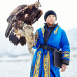 NURA, KAZAKHSTAN - FEBRUARY 23: Eagle on kid's hand in Nura near — Stock Photo