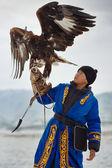 Bird hunter with a golden eagle (Aquila chrysaetos). Kazakhstan. — Stock Photo