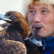 Bird hunter with a golden eagle (Aquila chrysaetos). Kazakhstan. — Stock Photo