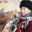 NURA, KAZAKHSTAN - FEBRUARY 23: Eagle on girl's hand in Nura nea — Stock Photo