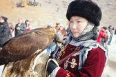 NURA, KAZAKHSTAN - FEBRUARY 23: Eagle on girl's hand in Nura nea — Stock Photo