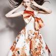 Young beautiful asian brunette in gorgeous dress, motion shot — Stock Photo