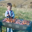 Small kid preparing BBQ — Stock Photo