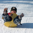 Kid on sled — Stock Photo