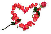 Heart shape with arrow from rose petals — Stock Photo