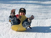 Kid on sled — Stock Photo
