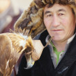 NURA, KAZAKHSTAN - FEBRUARY 23: Eagle on man's hand in Nura — Stock Photo #30575839