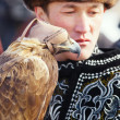 NURA, KAZAKHSTAN - FEBRUARY 23: Eagle on man's hand in Nura — Stock Photo #30576543