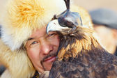 NURA, KAZAKHSTAN - FEBRUARY 23: Eagle on man's hand in Nura — Stock Photo
