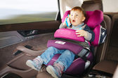 Luxury baby car seat for safety with happy kid — Stock Photo