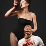 Vampire woman eating man heart — Stock Photo #35346095
