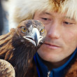 NURA, KAZAKHSTAN - FEBRUARY 23: Eagle on man's hand in Nura near — Stock Photo