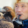 NURA, KAZAKHSTAN - FEBRUARY 23: Eagle on man's hand in Nura near — Photo