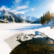 Big Almaty lake on december. Water, ice, mountains and snow. — Foto Stock