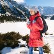Young woman take a walk on winter mountain slope (Big Almaty Lak — Stock Photo