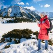 Young woman take a walk on winter mountain slope (Big Almaty Lak — Stock Photo #41465167