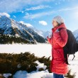 Young woman take a walk on winter mountain slope (Big Almaty Lak — Stock Photo #41465201