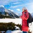 Young woman take a walk on winter mountain slope (Big Almaty Lak — Stock Photo