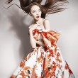 Young beautiful asian brunette in gorgeous dress, motion shot — Stock Photo #42388329