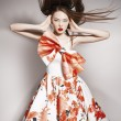 Young beautiful asian brunette in gorgeous dress, motion shot — Stock Photo #42388339