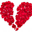 Broken heart made from rose petals — Stock Photo