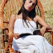 Royalty-Free Stock Photo: Beautiful girl sleeping in a chair in the field