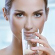 Healthy sport woman drinks cold water from glass — Stock Photo #20952895