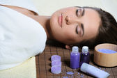 Young beautiful woman resting after spa procedures — Stock Photo