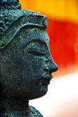 Near half-page photograph of a Buddha — Stock Photo