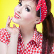 Stock Photo: Cheerful pin up girl