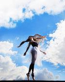 Ballerina dancing on the roof — Stock Photo