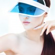 Portrait of attractive young adult woman with sun visor — Stock Photo #13407701