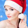 Attractive Santa girl on a festive background — Stock Photo #13407751