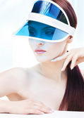 Portrait of attractive young adult woman with sun visor — Stock Photo