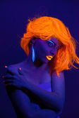 Uv light portrait, woman with glowing accessories and make up — Stock Photo