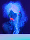 Fairy tale portrait in uv light — Stock Photo