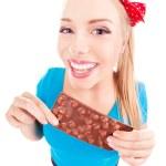 śmieszne podekscytowany dziewczyna z czekolady na białym tle — Zdjęcie stockowe