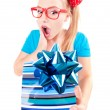 Funny girl excited by getting a present — Foto de Stock