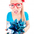 Stock Photo: Funny girl excited by getting a present