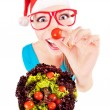 Funny santa girl playing with salad — Stock Photo #13877411