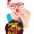 Stock Photo: Funny santa girl playing with salad